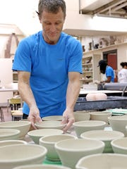 In this file photo, Steve Hilton, associate professor at Midwestern State University, lines up bowls at the 2018 Wichita Falls Area Food Bank Bowl-A-Thon at the Midwestern State University Fain Fine Arts building.