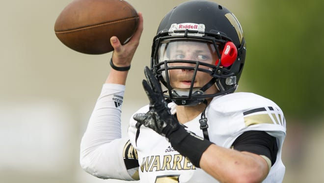 Warren Central High School junior Zach Summeier (7) warms up his arm during pre-game activities of a IHSAA varsity football game at Ben Davis High School, Friday, September 18, 2015.