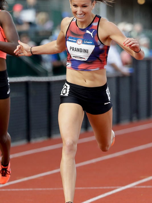 Jenna Prandini wins her heat during the semifinals of the women's 200-meter run at the U.S. Olympic Track and Field Trials, Saturday, July 9, 2016, in Eugene Ore. (AP Photo/Marcio Jose Sanchez)