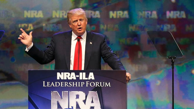If NRA members were at the Paris subway attacks 'you wouldn't have the same carnage,' said presidential candidate Donald Trump while making a handgun motion with his hand to NRA members Friday at Freedom Hall.