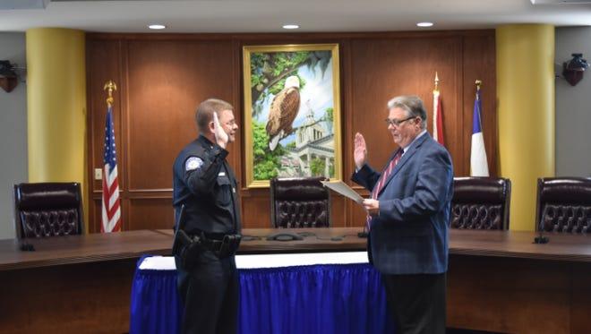 Greg Gibson (left) sworn in as police chief by TCC President Jim Murdaugh.