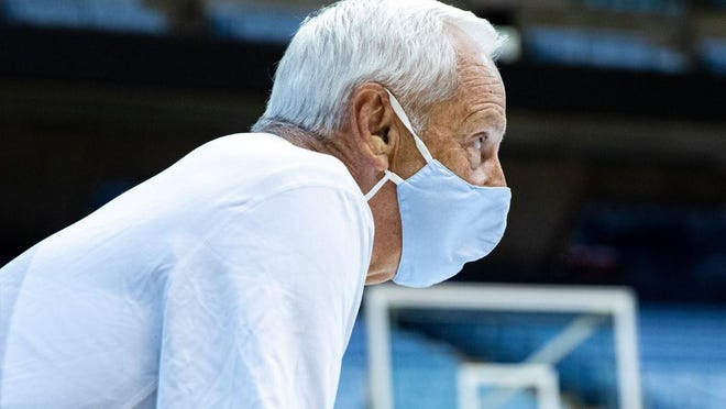 Coach Roy Williams looks on during a preseason practice for his North Carolina basketball team.