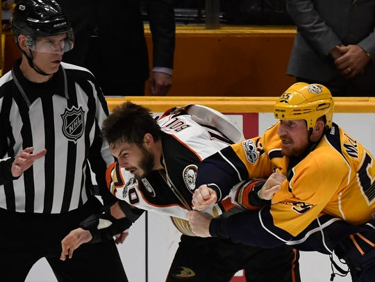 Predators left wing Cody McLeod (55) connects with