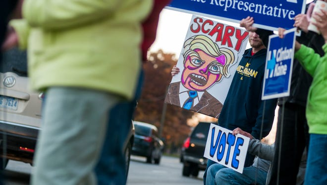 An anti-Trump sign is displayed Monday, Nov. 7, along Pine Grove Avenue in Port Huron.
