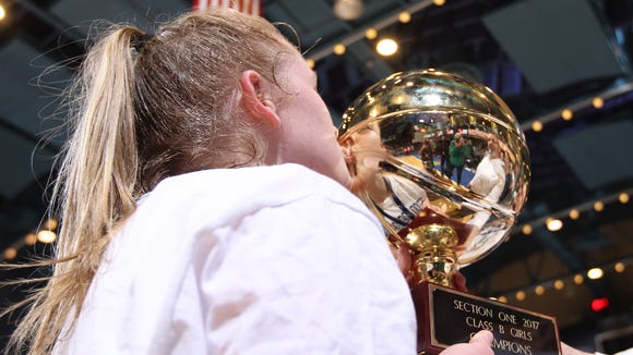 Irvington's Lindsay Halpin kisses the gold ball after defeating Briarcliff 58-44 in the Section 1 Class B girls final basketball game at the Westchester County Center in White Plains on Saturday, March 4, 2017.