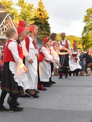 Children perform Scandinavian dances in authentic costume,