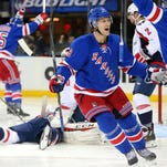 New York Rangers defenseman Kevin Klein (8) celebrates his goal against the Washington Capitals with New York Rangers center Derick Brassard (16) during the second period at Madison Square Garden.
