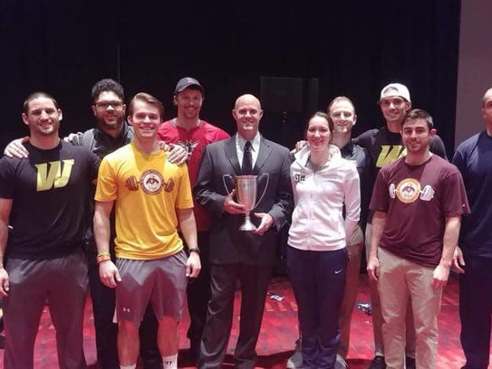 Matt Nein poses with members of Salisbury University after winning the 2018 College Strength and Conditioning Coach of the Year award.