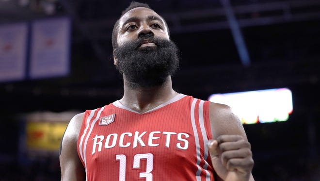 Houston Rockets guard James Harden (13) reacts after defeating the Oklahoma City Thunder during an NBA basketball game in Oklahoma City, Friday, Dec. 9, 2016.