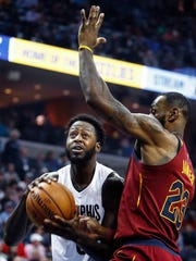 Memphis Grizzlies forward JaMychal Green (left) drives to the basket against Cleveland Cavaliers defender LeBron James (right) during first quarter action at the FedExForum in Memphis, Tenn., Friday, February 23, 2018.