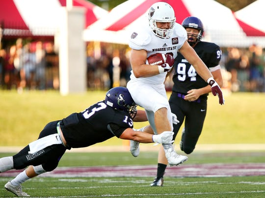 Missouri State Bears tight end Erik Furmanek (18) hurdles