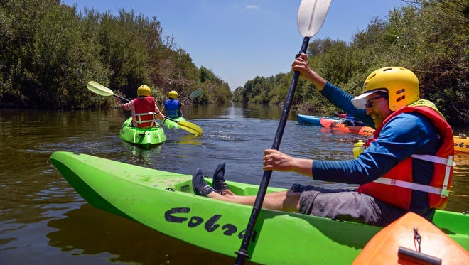 Antonio Pierola paddles up the Los Angeles River with a group from the Los Angeles Conservation Corps' Paddle the LA River Program.  The city  backs a $1 billion U.S. Army Corps of Engineers plan to restore and revitalize the 51-mile river that runs through Los Angeles and neighboring cities.