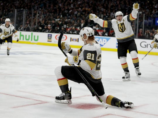 Vegas Golden Knights center Cody Eakin (21) celebrates after scoring against the Los Angeles Kings during the third period of Game 3 of an NHL hockey first-round playoff series in Los Angeles, Sunday, April 15, 2018. (AP Photo/Chris Carlson)