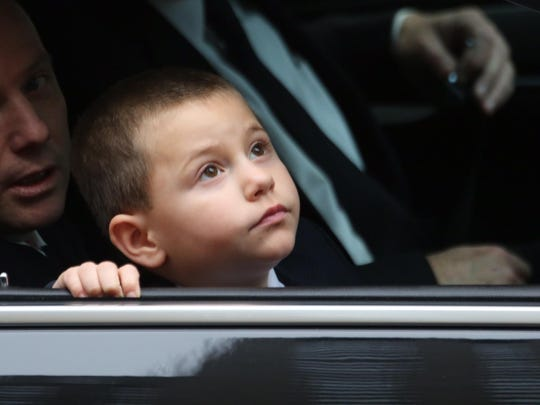 Ryan Lemm, the son of Joseph Lemm, looks out from a limousine as his father's casket arrives at St. Patrick's Cathedral in Manhattan before the funeral of the West Harrison resident. Lemm, a member of the NYPD and Air National Guard, was killed fighting in Afghanistan on Dec. 21st.