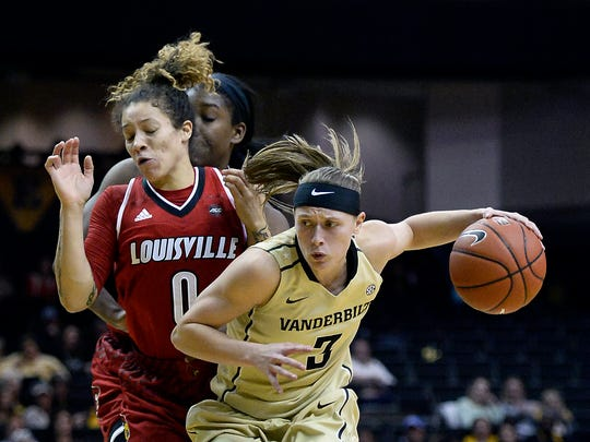 Vanderbilt guard Rachel Bell (3) drives past Louisville guard Briahanna Jackson (0) during the second half of an NCAA college basketball game, Wednesday, Dec. 21, 2016, in Nashville, Tenn. Louisville won 78-66.