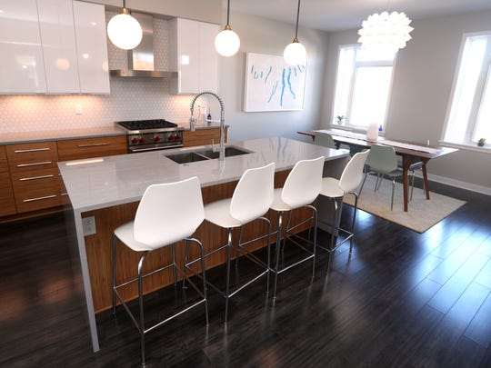 Countertop seating and a dining area in Molly Sanjule's townhouse.