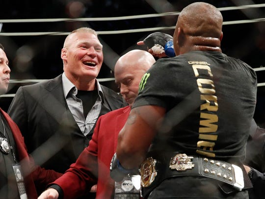 Brock Lesnar, left, taunts Daniel Cormier after Cormier's heavyweight title mixed martial arts bout at against Stipe Miocic at UFC 226 on July 7, 2018, in Las Vegas.