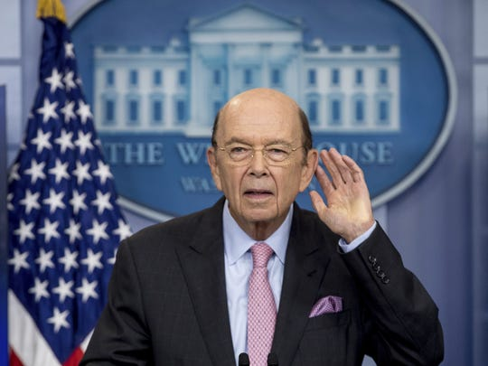 Commerce Secretary Wilbur Ross takes a question as