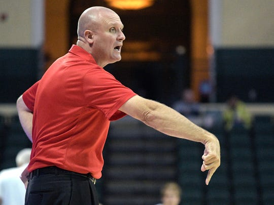 Marist head coach Mike Maker calls out instructions against Oregon State at the AdvoCare Invitational on Sunday.