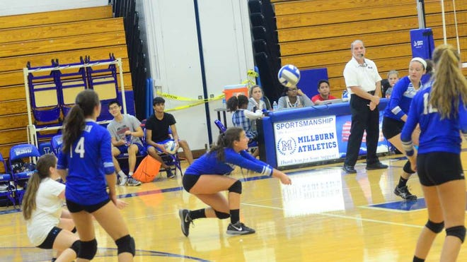Lais Santos of Millburn High School's varsity girls volleyball team sets up a return during a Sept. 29 match against visiting Mount St. Dominic. Looking on are Emily Alpert (white jersey), Olivia Goldenberg (14) Chloe Nimmer (white headband) and Angela Saggio.