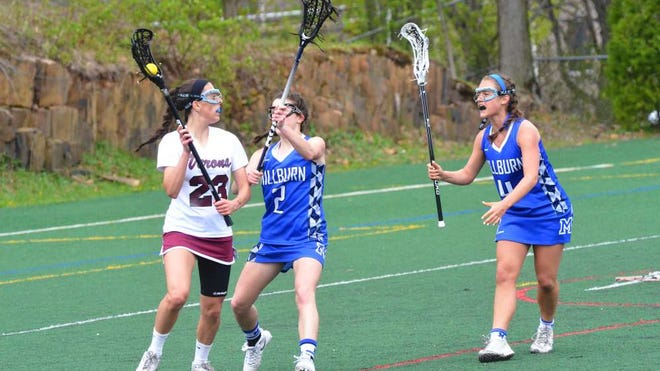 Catherine O'Neill (2) of Millburn High School marks Verona High School's Ava Anderson April 23 in the first half of an Essex County Tournament first round game at Verona's Centennial Field. At right is Millburn's Olivia Stack. Fourth-seeded Verona held on to edge fifth-seeded Millburn 10-8.
