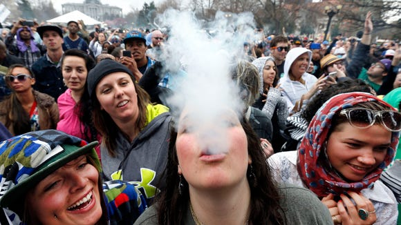 In this April 2014 file photo, partygoers dance and smoke pot on the first of two days at the annual 4/20 marijuana festival in Denver. (AP Photo/Brennan Linsley, File)