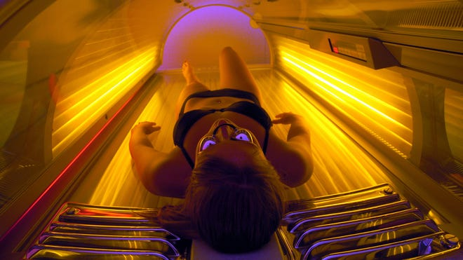 In preparation for spring break, Maria Cornette, a student at St. Norbert College in De DePere, Wis., works on her tan at a shop in Green Bay, Wis. Thursday, March 11, 2004.