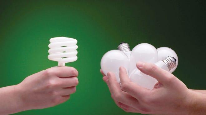 CFL light bulb being compared to regular light bulbs.
