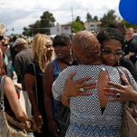 Rita Washington, right, daughter of B.B. King, embraces mourners waiting in line during a public viewing of the blues icon Friday in Las Vegas. King died last week at 89.