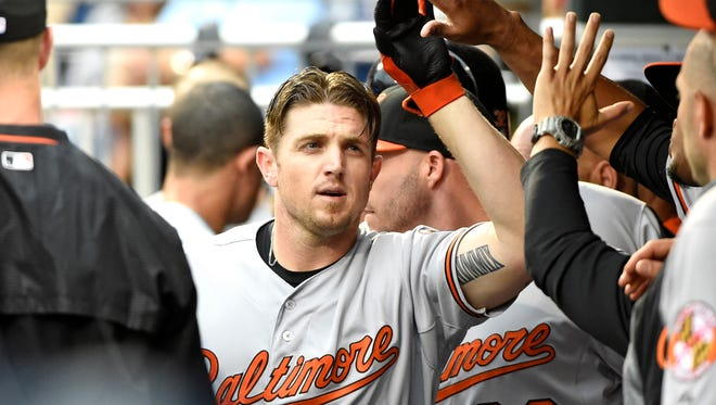 Orioles first baseman Chris Parmelee celebrates in the dugout after hitting a home run during the first inning.