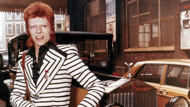 David Bowie poses beside his Rolls Royce in May 1973. (AP Photo)