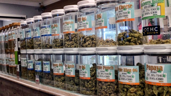 Jars of medical marijuana on display on the counter of Western Caregivers Medical marijuana dispensary in Los Angeles.