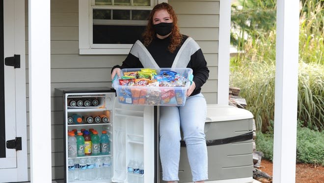 "Emily Fowler has placed a small regfrigerator and bucket of snacks on the porch of her Brewster home as a treat for delivery drivers. ""It's just something to make them smile during these difficult days,"" she said."
