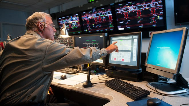 Train dispatcher Jim Elwell works in the PATCO Center Tower in Camden.  05.30.14
