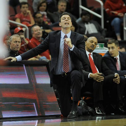 Louisville acting head coach David Padgett (left) yells