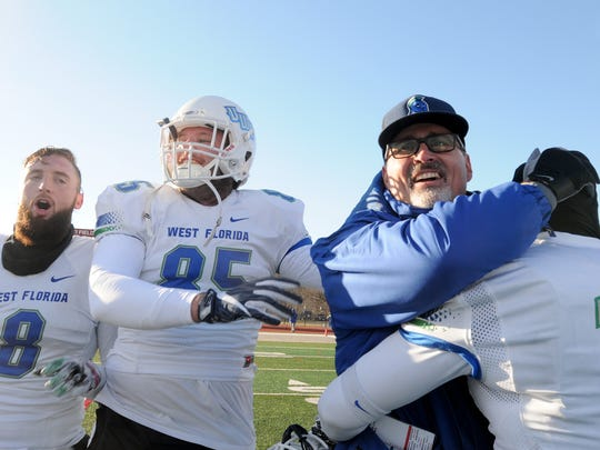 UWF head coach Pete Shinnick celebrates with players after the Argos' 27-17 win over Indiana (Pa.) in the 2017 NCAA Division II semifinals in Indiana, Pennsylvania. Temperatures at kickoff were below 30 degrees Fahrenheit.