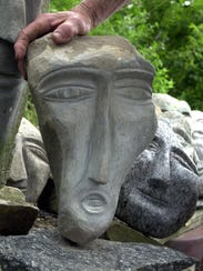A face carved by Ted Ludwiczak in this 2003 file photo.
