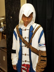 Jacob Ruiz, 12, of Tulare, tries on an Assassin's Creed