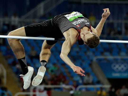 Canada's gold medal winner Derek Drouin competes in the men's high jump final, during the athletics competitions in the Olympic stadium of the 2016 Summer Olympics in Rio de Janeiro, Aug. 16, 2016.