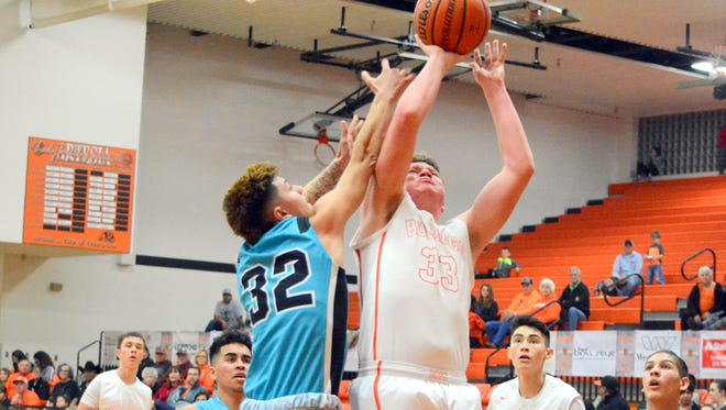 Artesia's Taylor Null puts up a shot in the first quarter on Saturday.