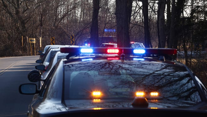 In this file photo, a state police car is parked on a road in the Town of Wappinger.
