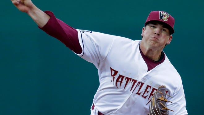 The Wisconsin Timber Rattlers's #25 pitcher Taylor Williams against the Peoria Chiefs during the Rattlers' season opener at Neuroscience Group Field at Fox Cities Stadium April 3, 2014 in Grand Chute, Wis.  Wm.Glasheen/Post-Crescent Media