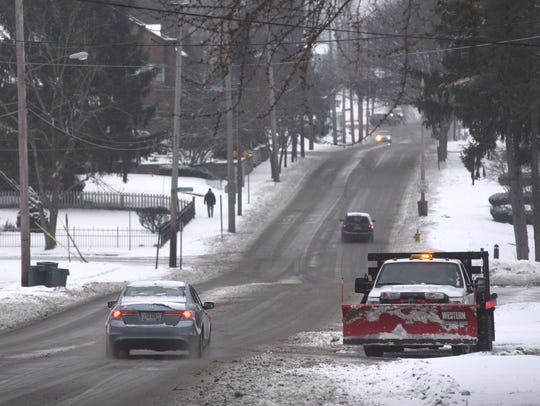 A plow from Zanesville City Schools stops its work
