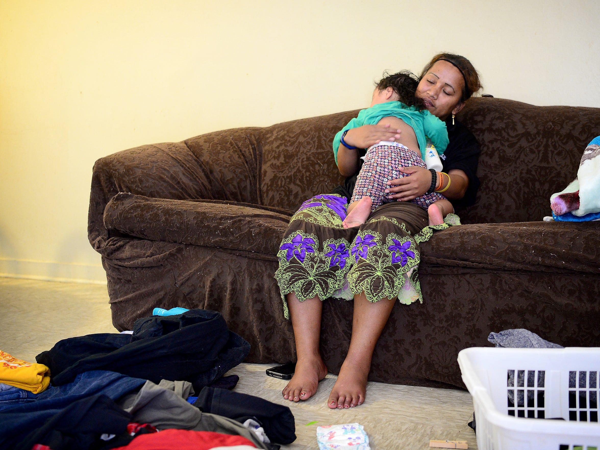 Deaverview resident Elena Jacklick rocks her daughter,