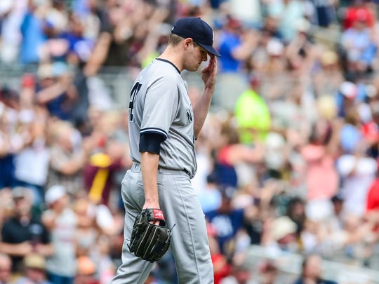 Yankees starting pitcher Jordan Montgomery (47) reacts after giving up a three run home run to Minnesota Twins third baseman Miguel Sano (not pictured) during the second inning at Target Field on Wednesday, July 19, 2017.