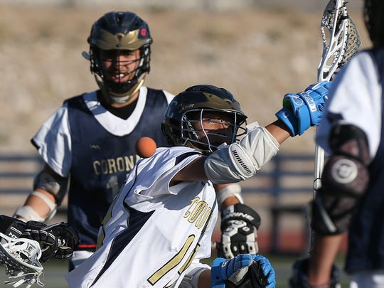 Giani Catucci, center, loses the ball as he tries to pass it to a teammate during Coronado Lacrosse's practice.