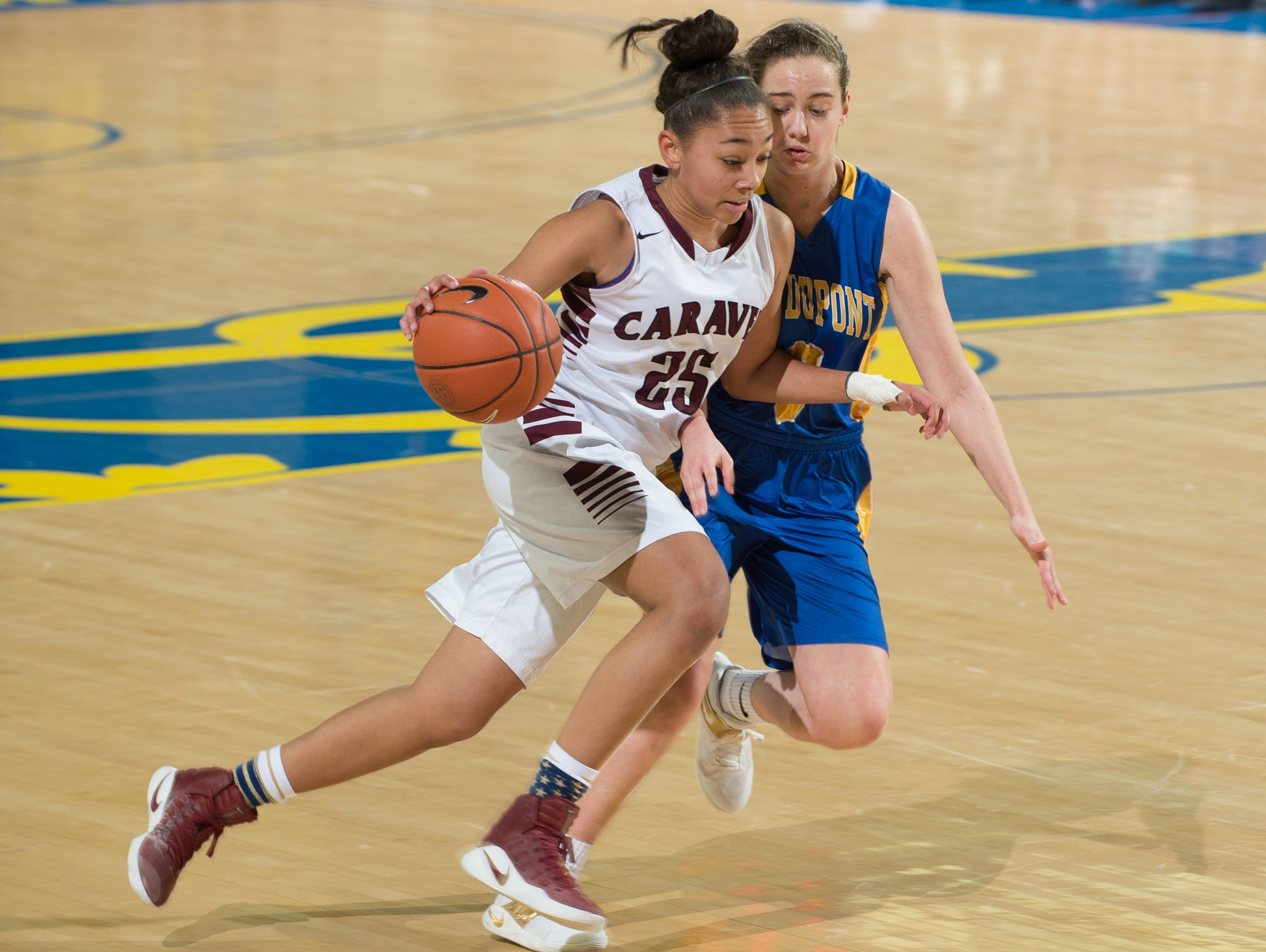 Caravel's Terea Hunt (25) drives to the hoop in the quarterfinals of DIAA Girls Basketball Tournament at the University of Delaware against A.I. duPont.