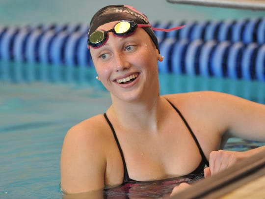 Amy Bilquist, who swims backstroke and freestyle for the Carmel Swim Club, practicing at the Carmel High School natatorium Tuesday July 15, 2014.