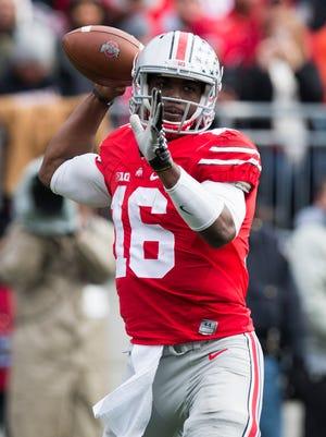Ohio State quarterback J.T. Barrett passes against the Indiana Hoosiers at Ohio Stadium.