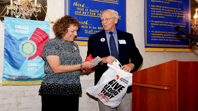 Ron McMahon, blood drive organizer for Vineland Rotary Club, presents Rotarian Linda Foster with recognition for donating blood consistently since the club's first blood drive in January 1997.